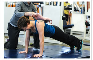 Susan Frikken applying a sandbag during plank